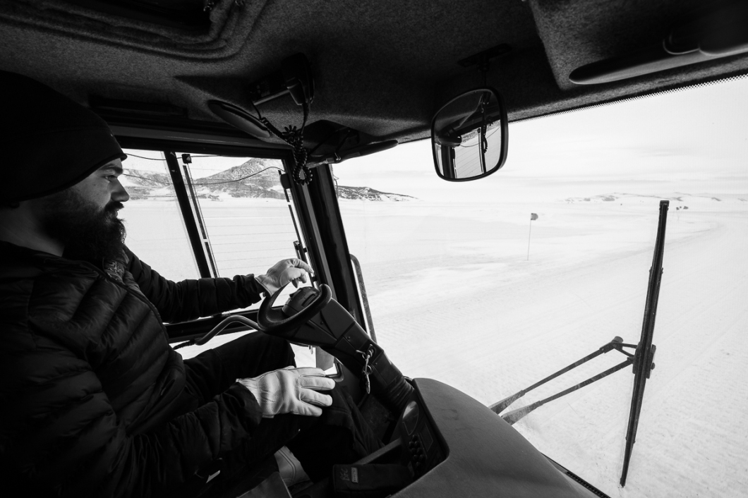 Kevin Johnson driving us out on the sea ice in a piston bully.