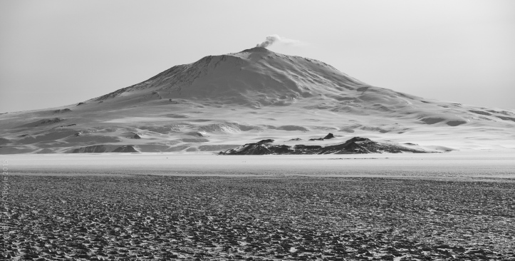 Mount Erebus and the dark area below the volcano is the Hut Point Peninsula with McMurdo inside the arms of the dark area.