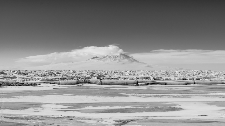 Old ice on Explorers Cove, with Mount Erebus over 50 miles away